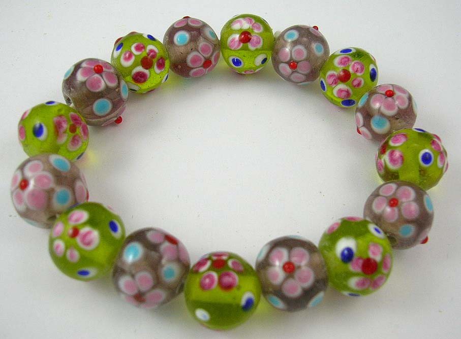 buy jewelry online store delivers green and pink bracelet with flower pattern